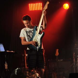 Teenage rock guitar student